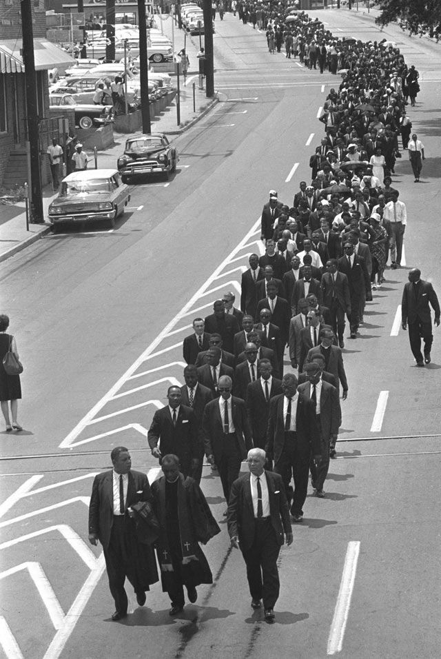Mourners march to the Jackson, Mississippi funeral home following services for slain civil rights leader Medgar Evers.