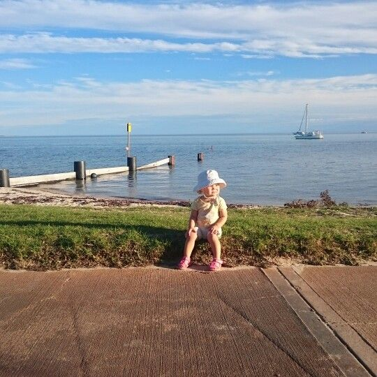 My daughter chillin on.the foreshore