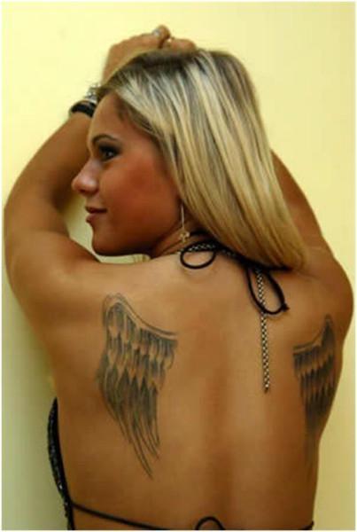 Dorota Doda Rabczewska. Doda Elektroda has a pair of angel wings tattooed on her back