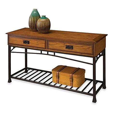 Discover a refreshing interpretation of a nostalgic design in the Home Styles Modern Craftsman distressed oak sofa table.