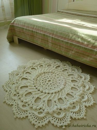 A doily rug from a Russian site, crocheted with crochet hook #5 and 5mm cotton cord. Sadly, no tutorial. I think I can figure it out.