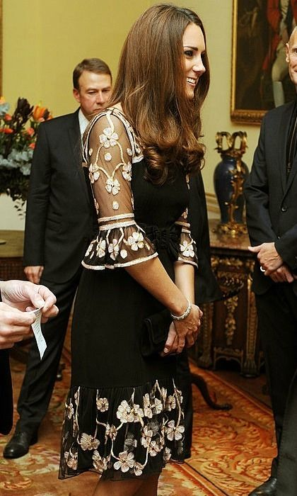 The Duchess made a floral statement in a Temperley frock for the 2012 royal reception held for Team GB Olympic and Paralympic Medalists.    Photo: John Stillwell - WPA Pool/Getty Images