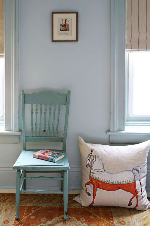 Any electrician can handle a basic rewiring job like the one done on this  oral-etched light texture. So if you spot a knockout piece that wasn't made in the last 50 years, don't pass it up, says Albano. Same goes for the little wooden chair and sweet iron bed frame, which are painted in shades of blue to play up the space's fun energy. Albano does warn that many antique bed frames are sized differently, which is why you should measure before you buy so you can get the right mattress; some…