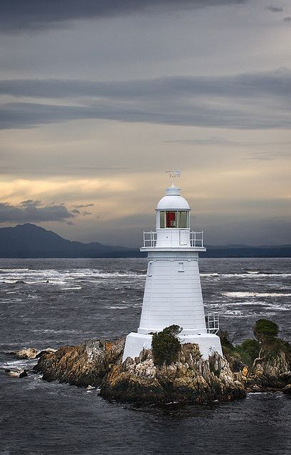 Hells Gate lighthouse standing on the entrance to Macquarie Harbour, known as Hells Gate It is a notoriously shallow and dangerous channel entrance to the harbour. The name of the channel relates to the original convicts' claim that it was their point of 'entrance to Hell,' their Hell being the Macquarie Harbour Penal Station on Sarah Island and the outlying surrounds of the harbour. es Lighthouse | Flickr - Photo Sharing!