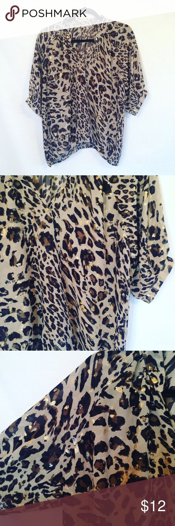 """Charlotte Russe leopard metallic blouse Great leopard print top from charlotte russe. Sheer tan, black and metallic gold blouse. 3/4 sleeves. Banded at the bottom. Longer in the back. Good used condition.     armpit to armpit: approx 25.5"""" length: approx 23"""" (longer in the back) Charlotte Russe Tops Blouses"""