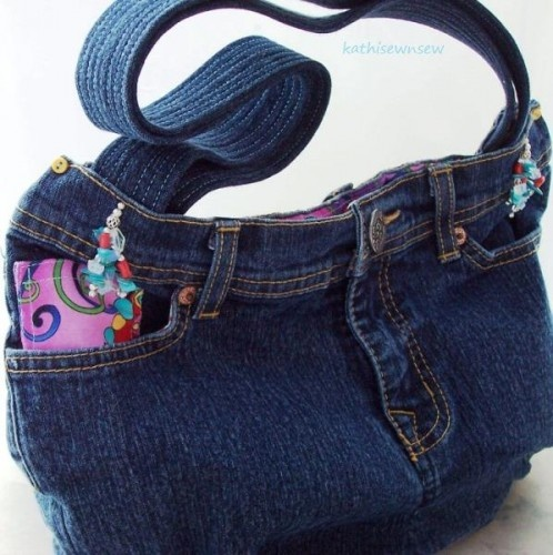 This denim jeans purse tote is made with recycled blue jeans with colorful, floral cotton lining and all the pockets to put all your things. There are 4 outside pockets and 2 inside pockets and a snap closure. This bag has 2 soft and comfy straps with a 10 1/2 in. drop. It hangs nicely on the shoulder.    Measurements:  14 inches across  8 inches deep.
