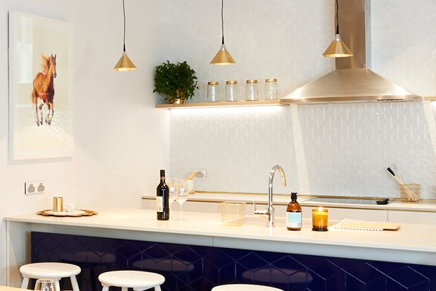 The  dark blue compliments the Caesarstone London Grey kitchen benchtop