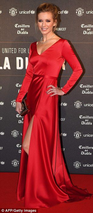 Making a statement: The Countdown presenter looked incredible in a bright red silk dress f...