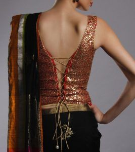 Red and gold sequin sleeveless blouse with corset back and black saree