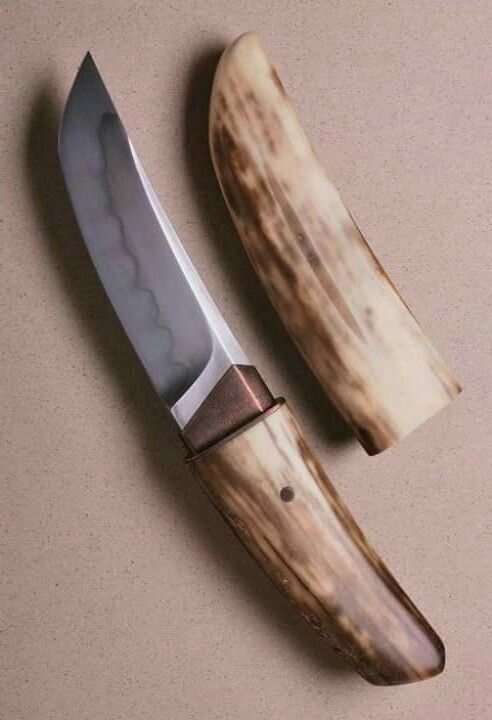 Sleeve Kwaiken made by Anders Hogstrom. Sheath and handle of fossilised walrus tusk. Blade length 4,5 in.