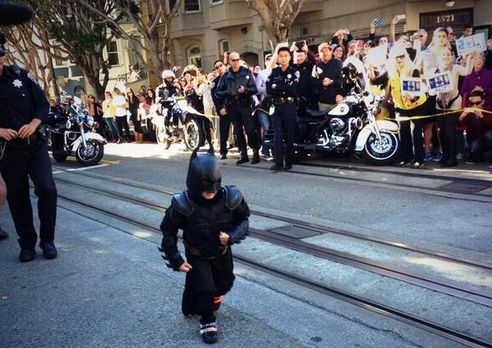 "5-year-old Batkid serves ""Gotham"" (SF) for a day thanks to the Make-A-Wish Foundation. This MAY be the cutest things I've ever seen. I guess there IS still some good left in people. :)"