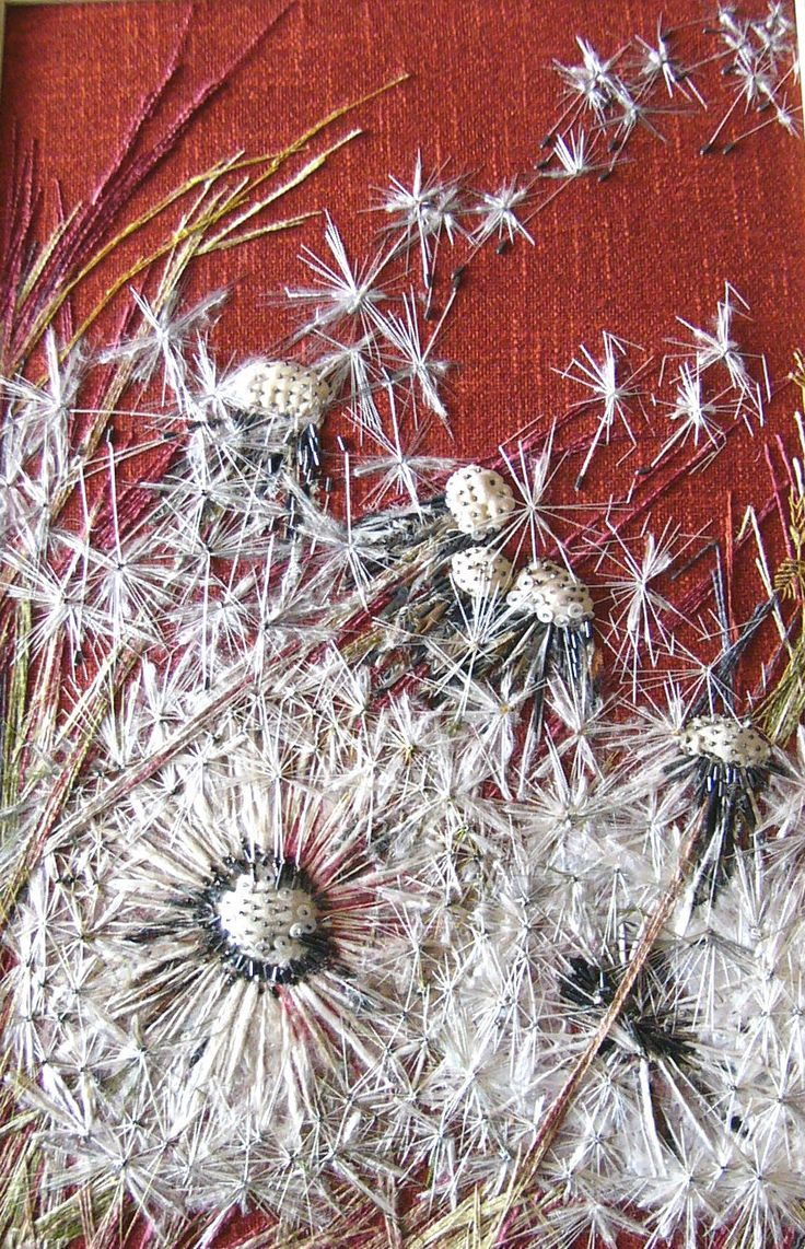 'Dandelion' -  1973 design of dandelion heads on rust-coloured furnishing fabric using hand embroidery with silks, wools and beads.