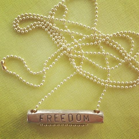 """Hand made in Thailand, the word FREEDOM has been stamped on to a brass bar to remind us all of the importance of PREVENTION on the path to Freedom.  The chain is 33.5"""" long and can be cut to be shortened."""