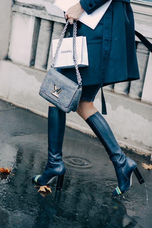 Louis Vuitton handbag with knee hight boots.