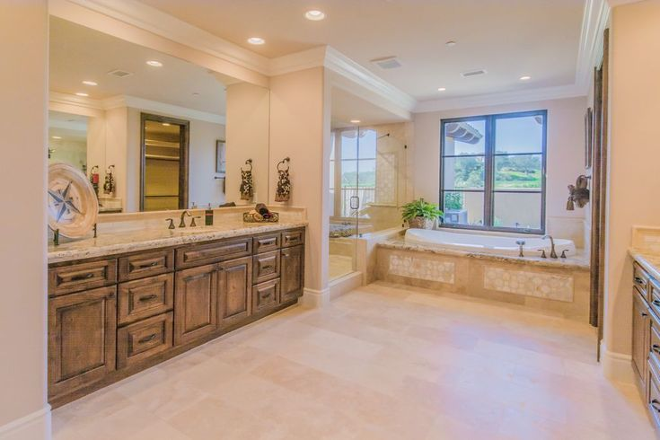 Mediterranean Master Bathroom with Frameless Shower Doors By Dulles Glass and Mirror, Crown molding, Built-in bookshelf