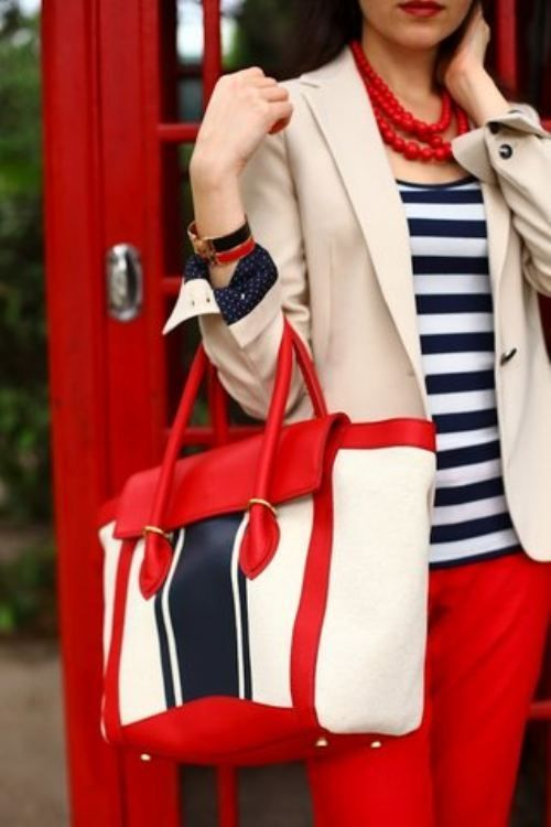 cream coat strip sweater with red pants and hand bag