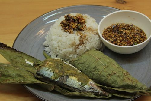 Fish baked in turmeric leaves