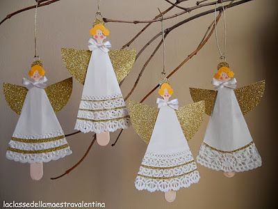 Angel ornaments made from paper doilies (dress) and scrap paper (wings).