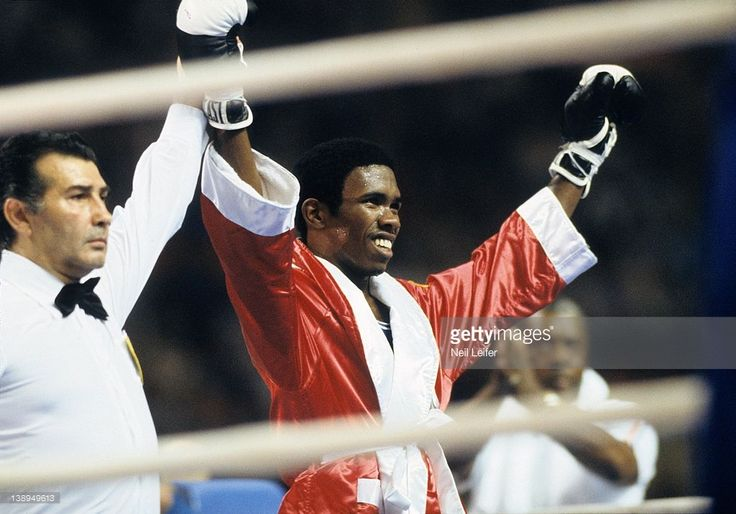 USA Howard Davis Jr. (333) victorious on medal stand after winning gold vs Romania Simion Cutov (279) during Lightweight Final at Maurice Richard Arena. Neil Leifer