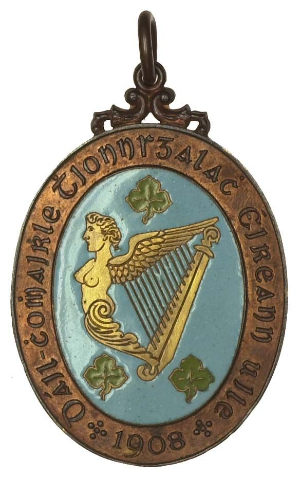 4th All-Ireland Industrial Conference, Galway, 1908, an oval bronze-gilt and enamel Foreign Delegates medal by West, maid of Erin harp dividing three shamrocks, rev. arms of Galway city, 66 x 45mm (cf. Trench, Irish Numismatics, Jan-Feb. 1976, pp.23-4). Extremely fine, attractive; with clip and ring for suspension