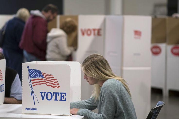The Obama administration pondered deploying armed federal agents to polling places last November to counter any potential cyberattacks targeting the U.S. election system, according to a newly released playbook prepared during last year's race.