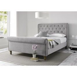 Add a touch of style and grandeur to your bedroom with our Valencia Sleigh bed. This bed is a contemporary twist on a traditional design. The beautiful steel grey upholstery is combined with deep buttoning to create a bed that would be an impressive focal point in any bedroom. Subtle styling details include attractive weathered effect wooden feet. The bed comes with as sprung slatted base for extra comfort and support. Please note fabric swatch samples are available upon request.