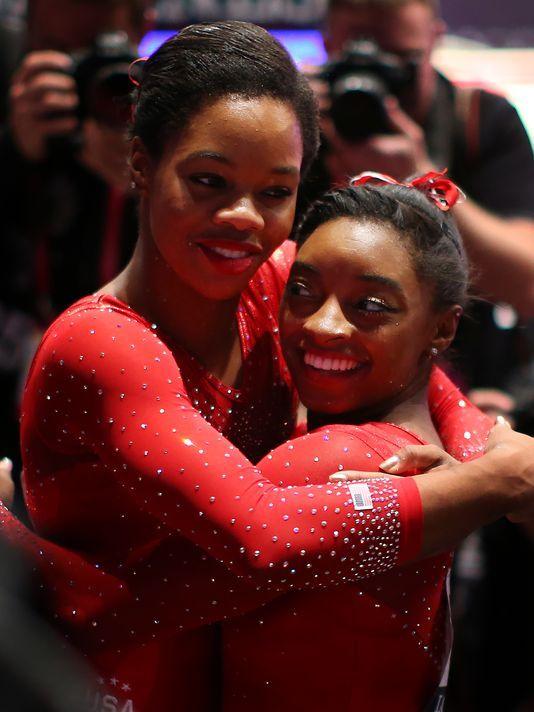 102915-Gabby Douglas, Simone Biles