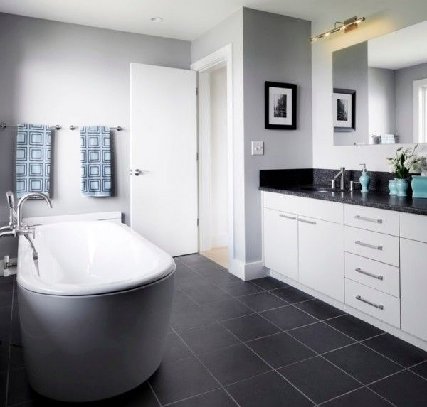 Use these dark gray tiles in bathroom (floor and shower stall) add marble boarder in shower a d marble countertops