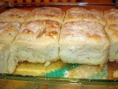 Ingredients :    4 cups Bisquick  1 cup sour cream  1 cup 7-up  1/2 cup melted butter          Directions :    Mix bisquick, sour cream and 7 up. Dough will be very soft - don't worry Knead and fold dough until coated with your