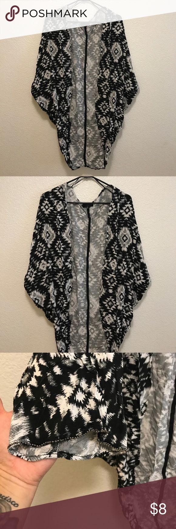 Cotton on kimono size Xs Worn twice to pool and washed. Very pretty the sleeve detail is beautiful. You can also wear casual with a day outfit Cotton On Sweaters Cardigans