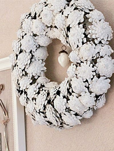 white pinecone wreath...I've never seen the pinecone bottoms displayed like this-so pretty!! #whitewreath #whitedecor