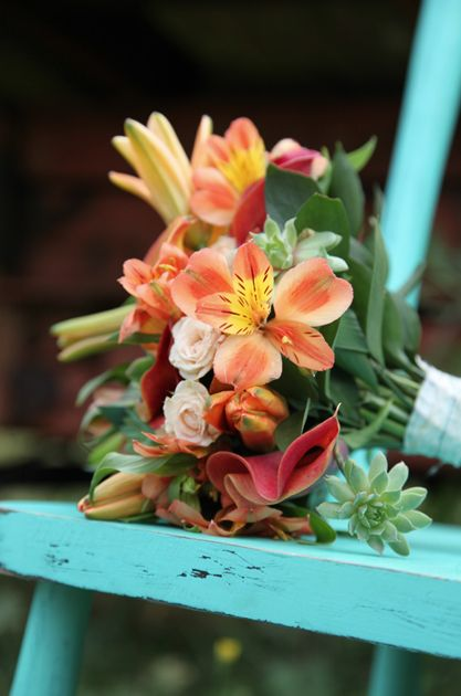 Alstromaria, orange mini calla, champagne spray roses , succulents with teal accents Larissa and Richie | Teal and Rust |Rust-ic Chic  Backyard Celebrations