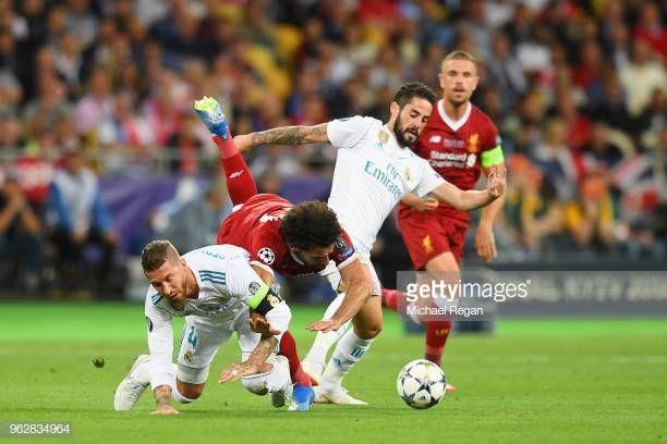 Mohamed Salah Of Liverpool Falls And Lands On His Shoulder After A Real Madrid Captain Liverpool Mohamed Salah