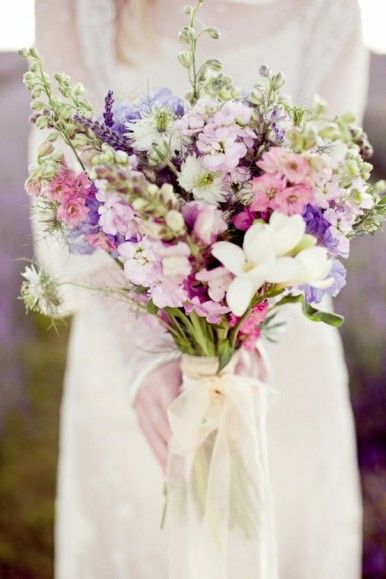 Purple, pink, and white bouquet. Larkspur and stock vertical wildflower bouquet.