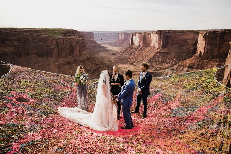Occasion of Gravity: 400-Foot-High Wedding on Netting Over Moab Canyon | Urbanist
