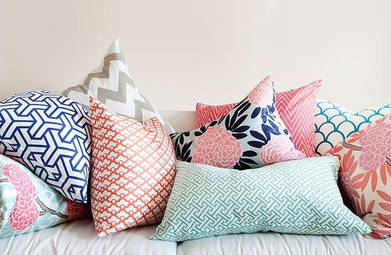 Navy, coral and jade pattern pillows.