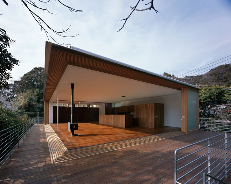 Love this -- the walls of the livingroom/kitchen can just go away and open to the day.  Oh, would I love to live here.  Thanks to tezuka architects: house to catch the mountain