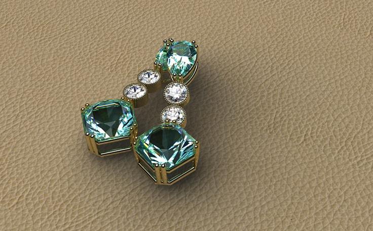 PENDIENTES GRANE Realizados en oro amarillo y berilos aguamarinas de dos tallas diferentes. La superior en talla poire, la inferior en talla hexagonal y el intermedio está compuesto por dos diamantes talla brillante.