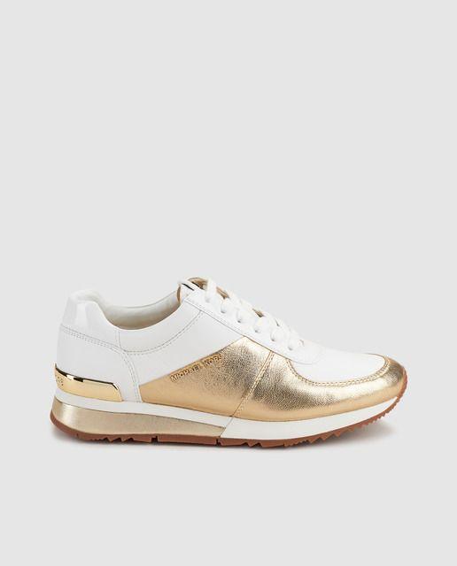 ec174a9c Zapatillas de piel de mujer Michael Kors de color blanco con detalles  metalizado. Modelo ALLIE WRAP TRAINER.