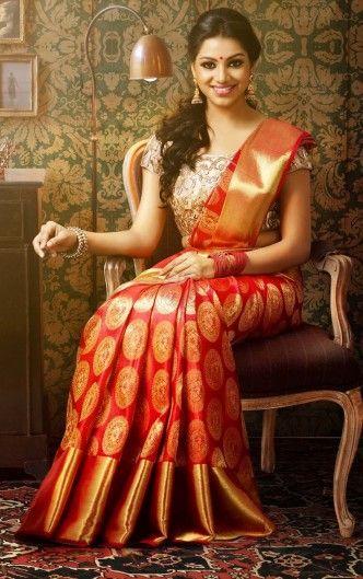 Beautiful red kanjivaram saree with plane red zari border