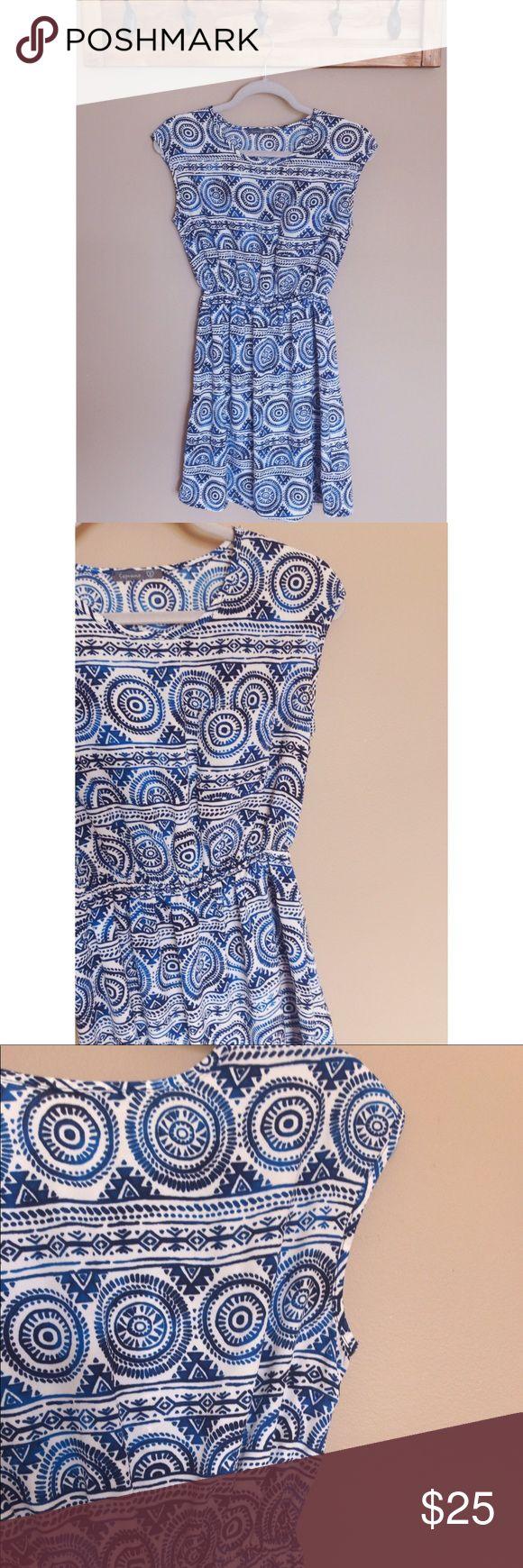 Printed Dress Light weight dress featuring a semi cap sleeve, flattering elastic band waist and a unique Aztec print. Perfect summer work dress! Soprano Dresses