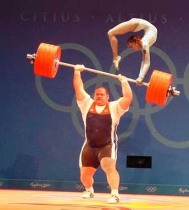 He is so strong but looks like the girl on top is tilting his bar!