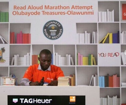 """A Nigerian, Olawunmi Bayode is currently attemptingto break a  Guinness World Record in the """"Longest Marathon Reading Aloud"""" C..."""