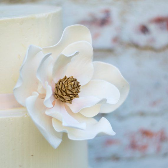 Magnolia Sugar Flower With Blush Details And Gold Center Unique Wedding Cake Topper And Gumpaste Decorations Wedding Cake Toppers Unique Sugar Flowers Wedding Cake Toppers