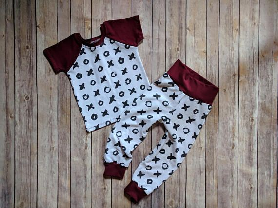 The beautiful, soft, XO Cotton Lycra fabric is accented with soft Burgundy Cotton Lycra fabric on the sleeves.  Be sure to check out our sweet Valentines pants to complete the ensemble!  All seams are completed using a serger with stretch thread. This set is handmade to order.