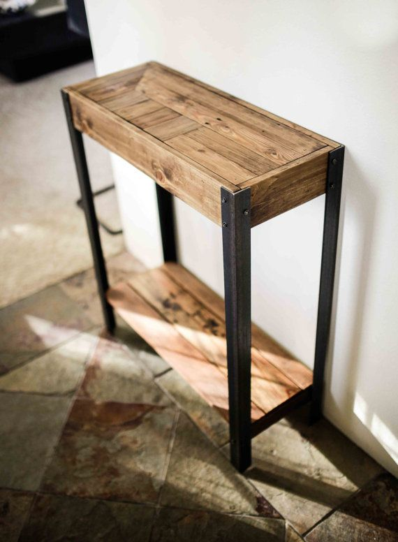 Pallet Wood Entry Hall Side Table  A great entry way table made out of repurposed wood from a pallet. Has amazing character and patina. Shows the rough life it probably has had, but cleaned up enough to make for a nice table for your entry way or hallway. All surfaces sanded and polished nice, but not too much to remove the history of the wood. Legs are an 1 1/2 metal angle iron, adding to the nice heft and feel of this desk.  Dimensions- 33T x 36W x 12D (approx) Wooden shelf 5 off of floor…