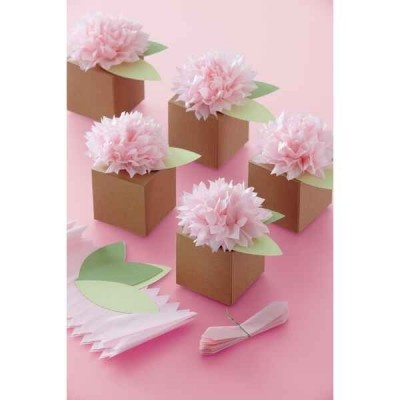 These favor boxes are brown and come with pink tissue paper flowers and green leaves on top.