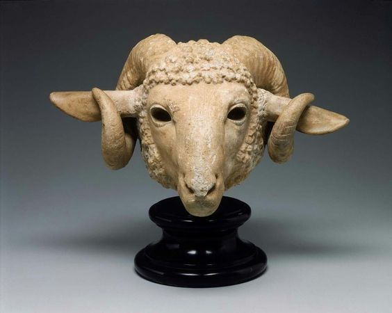 Ram's head, Greek, Late Classical period, 4th century B.C. The ears have been made too large and should lie back against the horns with the opening to the front. The horns should lie close to the sides of the head, as the re-worked fleece indicates, the eyelids have been patched with plaster and eyes inserted, 32 cm high. Museum Fine Arts Boston