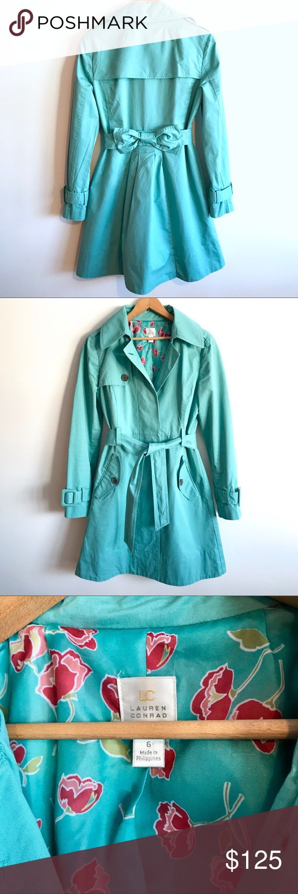 "LC LAUREN CONRAD Teal Trench Coat (6) LC Lauren Conrad Size 6 very gently worn teal trench coat with no flaws - in ""like new"" condition due to the fact that it's truly a statement piece. Concealed front buttons, colorful silk lining and adorable bow on the back. The belt ties in the front, is not removable (bow back is conveniently sewn into coat). Dry clean.  **Pet/Smoke Free Home** **Questions Welcome**  **Price Is Firm On Items $13 & Under** LC Lauren Conrad Jackets & Coats Trench Coats"