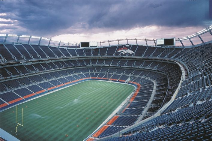 The Denver Broncos Stadium is an open-air, natural grass facility was opened for the 2001 NFL season. The 1.7 million square foot, 76,125-seat stadium has a horseshoe-shaped footprint that is open to the south.  Five concourse levels are made of poured-in-place, two-way post-tensioned concrete slabs. The concourses wrap around three seating bowls made of steel treads and risers, supported by a system of rakers and stringers.  The upper bowl rises and dips to make an undulating profile.